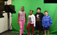 Thumbnail Image of four Hudson students in front of Green Screen