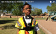 Thumbnail of Boy in construction vest standing in park wearing GoPro camera