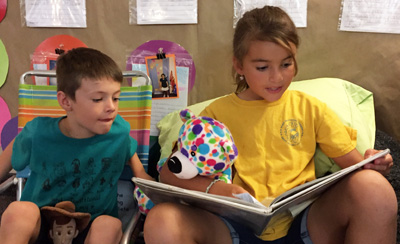 Reading Buddies - a boy and a girl reading a book