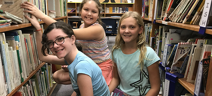 Rover adopt a shelf girls in library
