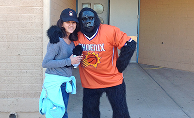Suns Gorilla poses with middle school girl