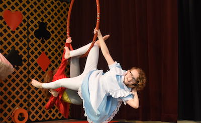 Girl student hanging on hoop smiling at camera