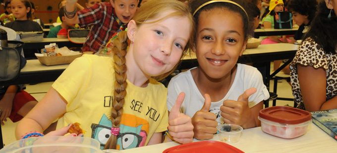 Image of two girls giving thumbs up