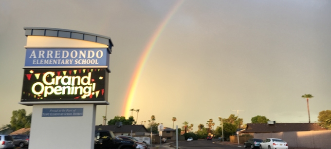 Image of Rainbow and Arredondo Marquee with words: Grand Opening