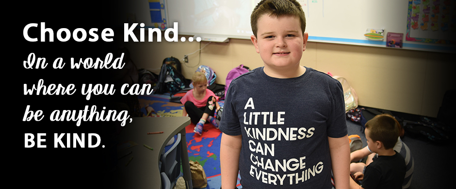 Boy wearing kindness shirt with words: A Little Kindness can Change Everything. Choose kind...