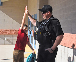 Officer giving high five