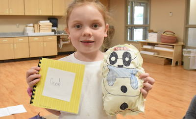 Girl smiling with story and stuffie