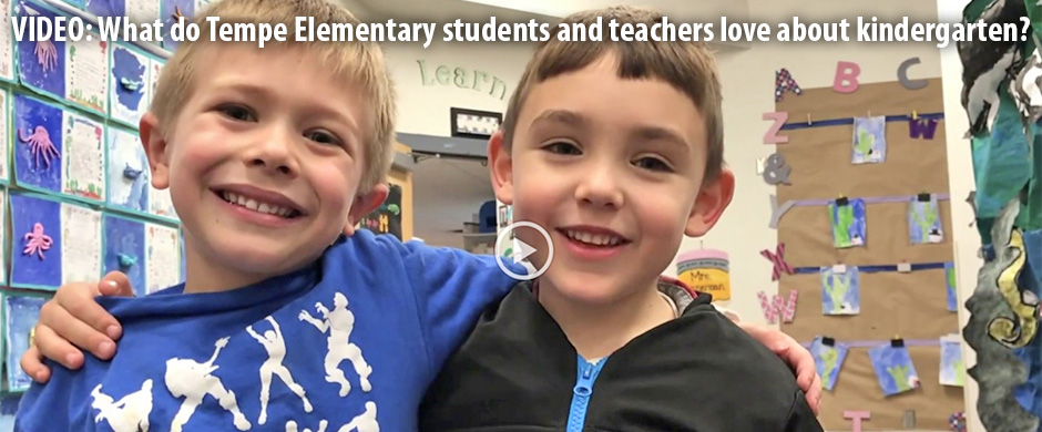 Two kindergarten boys with arms around each other's backs smiling with words VIDEO: What do Tempe Elementary students and teachers love about kindergarten?