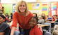 Crystal Carroll smiles with Scales student