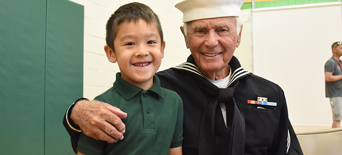 Student smiles with Veteran