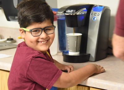 Boy smiling with coffee
